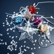 Stock Photo: Silver star and Gift boxes on black background