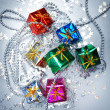 Colored and decorated shining gift boxes — Stock Photo