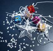 Silver star and Gift boxes on black background — Stock Photo