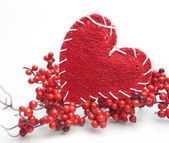Red heart and red berry branches — Stok fotoğraf