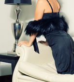 Woman wearing in black dress and luxury fur boa — Stock Photo