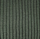 Green knitted wool background — Stock Photo