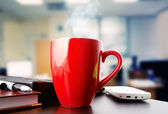 Coffee on a black table showing break or breakfast in office — Foto Stock