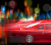 Motion blurred red car — Stock Photo