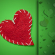 Red heart on green background — Stock Photo #22371091