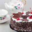 Stock Photo: Chocolate cake with cherry topping