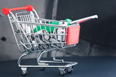 Screwdriver with interchangeable heads in shopping cart — Stock Photo