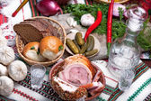 Photo of a table top full of vegetables, pork belly, bread and other foods — Stock Photo