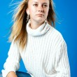 Young blond girl in white sweater — Stock Photo #2541688