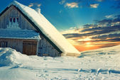 Wooden roof covered with snow — Stock Photo