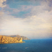 Summer landscape with sea, rocks and clouds sky - retro style picture — Stok fotoğraf