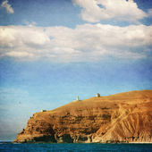 Rocky coastline and lighthouse, Crimea, Ukraine - picture in retro style — Stock Photo