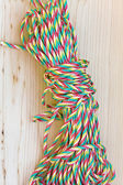 Bundles of colorful rope on wooden background — Stock Photo