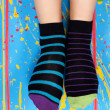 Female legs in striped socks — Stock Photo