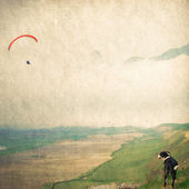Dog and flying paraglider — Stock Photo