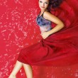 Fashion photo of young magnificent woman over red — Photo #33746351