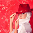 Young beautiful woman with white hair wearing red hat — Stock Photo