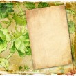 Old paper on grunge background with green flowers — Stock Photo