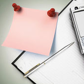 Note paper, business planner with a pen and a phone — Stock Photo