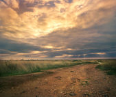 Landscape with road and clouds — Stockfoto