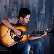 Young musician playing the guitar — Stock Photo