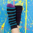 Legs in striped socks — Stock Photo