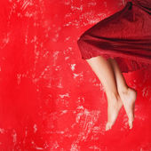 Woman's leg over red — Stock fotografie