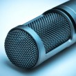 Picture of professional microphone on blue background — Stock Photo