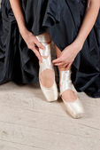 Woman's leg in ballet shoes — Stock Photo