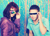 Happy young couple in funky sunglasses — Stock Photo