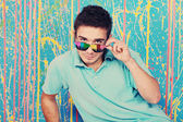 Happy young man in funky sunglasses — Stock Photo