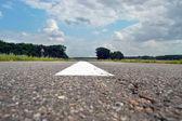 Asphalt road with white stripes — Stock Photo