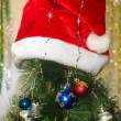 Red hat on a Christmas tree — Stock Photo