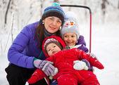 Family Having Fun in Snowy Woodland — Stock Photo