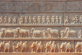 Wall with a carved relief: the Indian army — Stock Photo
