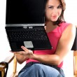 Woman With Laptop In Directors Chair — Stock Photo #6869937