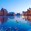 Old town in Gdansk with Motlawa river at dusk - Stock Photo