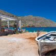 Boat on the coast of Crete at Spinalonga island — Stock Photo