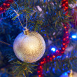 Bauble on the Christmas tree - Stockfoto