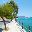 Empty road Mirabello Bay on Crete - Stock Photo