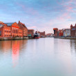 Old town in Gdansk with Motlawa river at sunset - Stock Photo