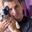 Man with french bulldog puppy — Stock Photo