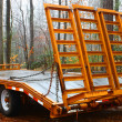 Stock Photo: Orange wooden floor trailer