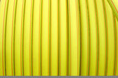 Yellow plastic conduit — Stock Photo