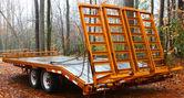 Orange wooden floor trailer — Stock Photo