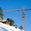 Crane construction machinery building equipment at snowy enviroment — Stock Photo