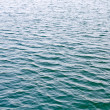 Royalty-Free Stock Photo: Ripple water surface texture at sea background