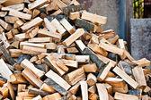 Log stockpile lumber for winter firewood heap — Stock Photo