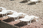 Beach bed or chair relaxation at sand — Stock Photo