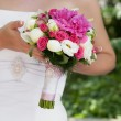 Bride with bouquet, closeup — Stock Photo #17009437